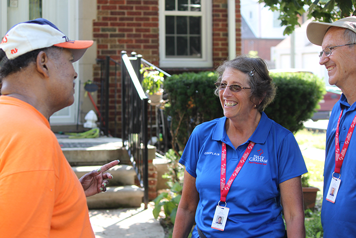 Rapid Response Team chaplains Pookie and Mike Mattingly talk with one of the Michigan homeowners affected by last week's flooding.
