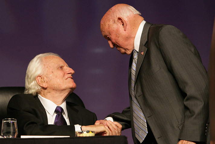 Billy Graham and Truett Cathy greet one another at a dinner event in Atlanta in 2006.