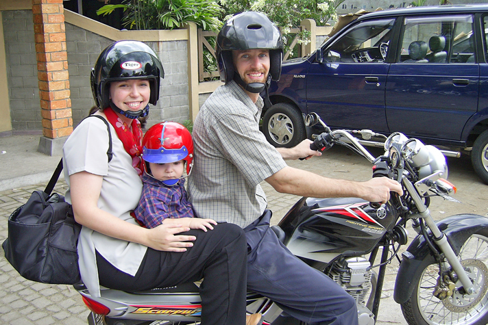 Missionary couple on motorcycle