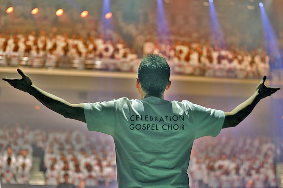 The choir gave a powerful performance as this man conducted from the floor of the arena.