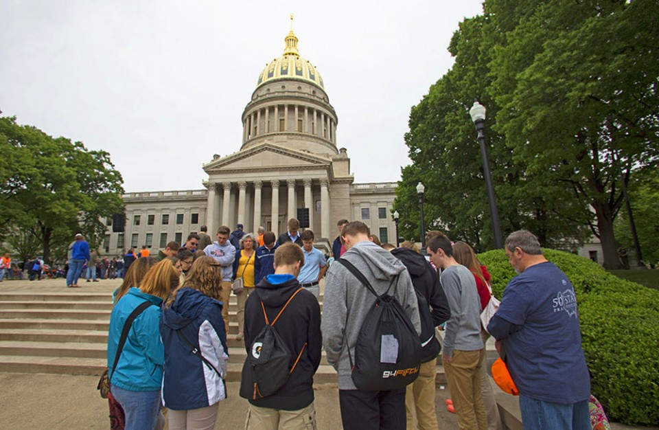 Students gathered to pray at the foot of the West Virginia State Capitol.