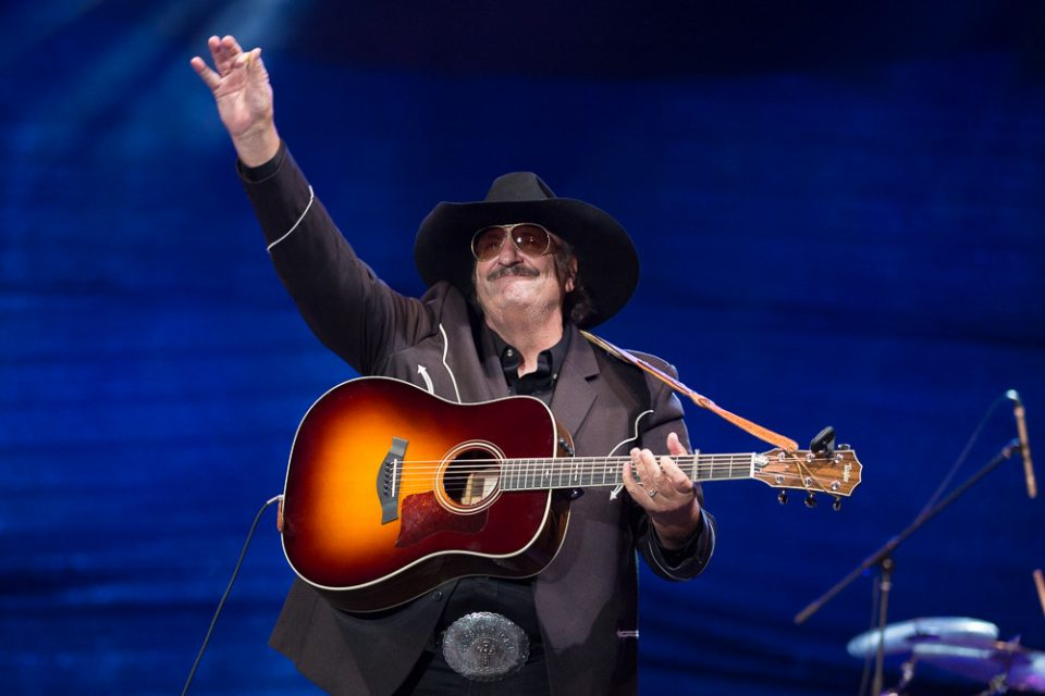 Dennis Agajanian with guitar