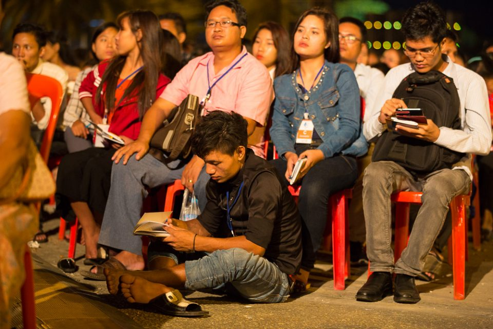 People sitting in chairs, on floor at Festival