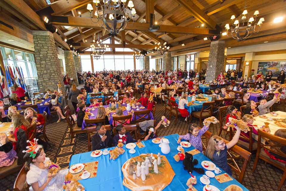 Hundreds of children take up nearly every seat in the dining room of the Billy Graham Evangelistic Association, right behind the Billy Graham Library. It was standing room only for their parents.