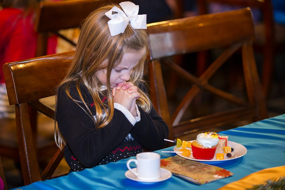 Little girl with hands folded, praying