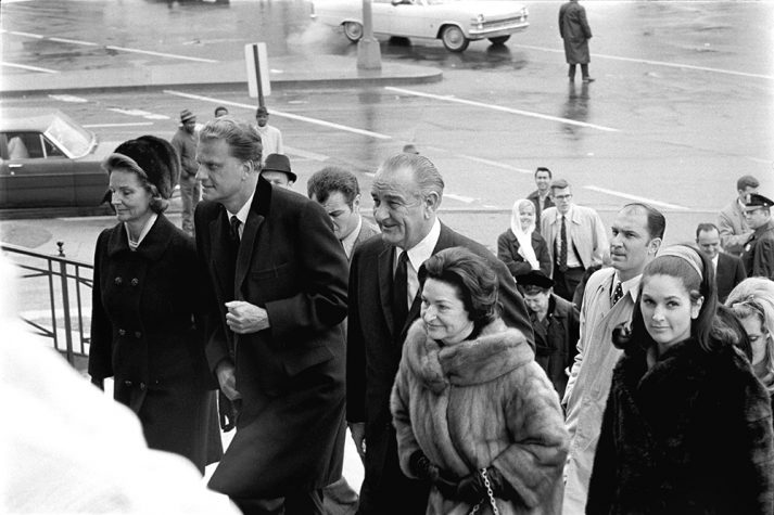 Billy Graham preached a sermon to President Lyndon B. Johnson and invited guests during a private event on Inauguration Day in 1965. Here, Billy Graham can be seen entering the Washington D.C. church with wife Ruth Bell Graham, President Johnson and his family.