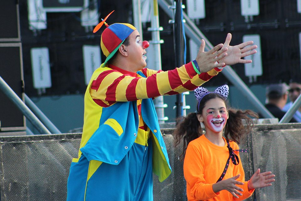 Man in clown suit, clapping