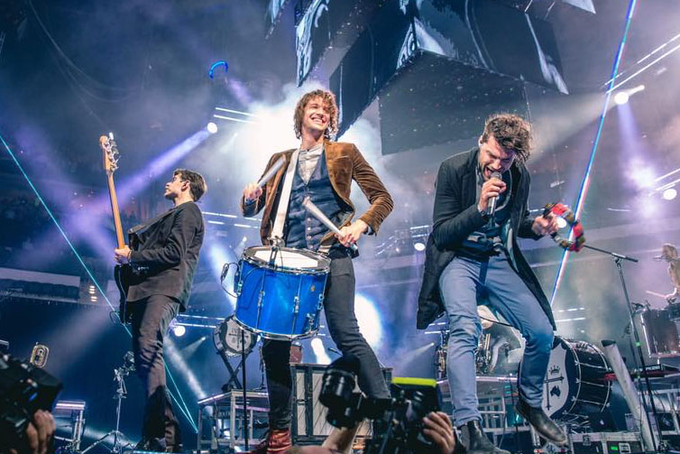 For King & Country brothers Luke Smallbone and Joel Smallbone and band members with drum, guitar, singing