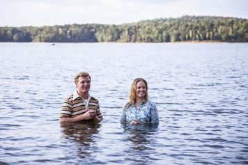 Actor Erika Christensen (portraying Leslie Strobel) and male actor in lake at her baptism
