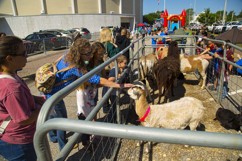 People petting farm animals at FunFest before KidzFest