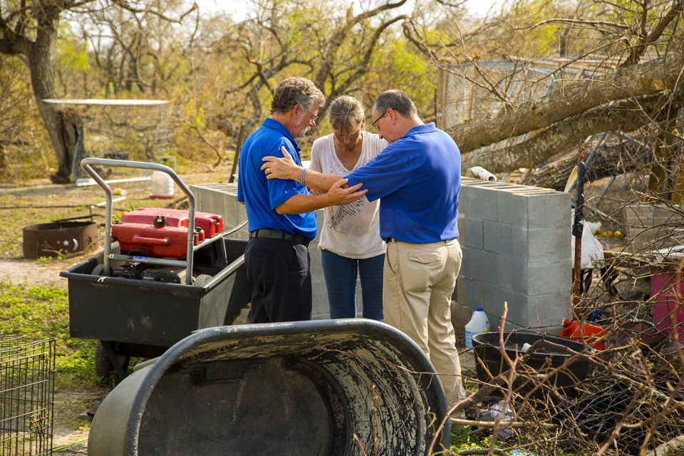 chaplains praying with woman in South Texas