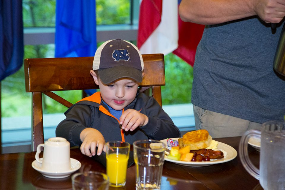 Little boy with plate of food