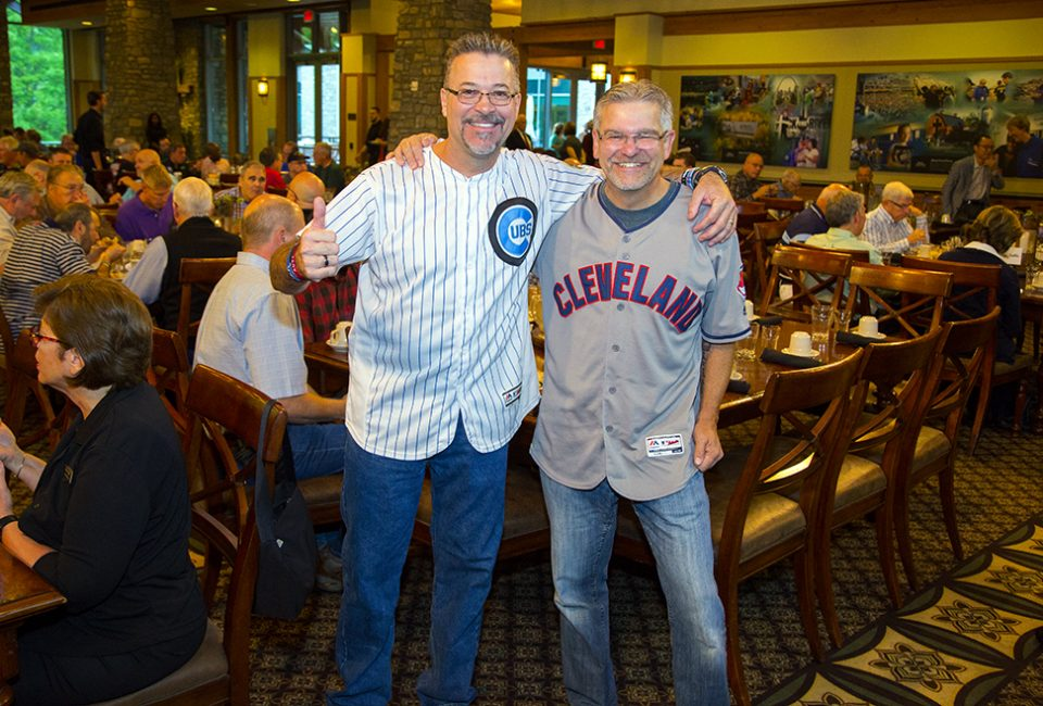 Men wearing Chicago Cubs and Cleveland Indians jerseys