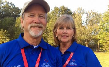 Carl and Mary Jo Hill in blue Rapid Response Team shirts