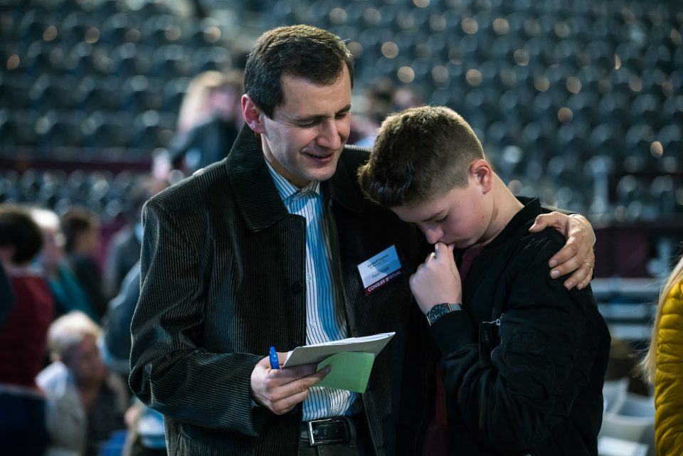 Counselor praying with young man
