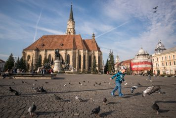 Saint Michael's Church in Cluj-Napoca; child chasing birds