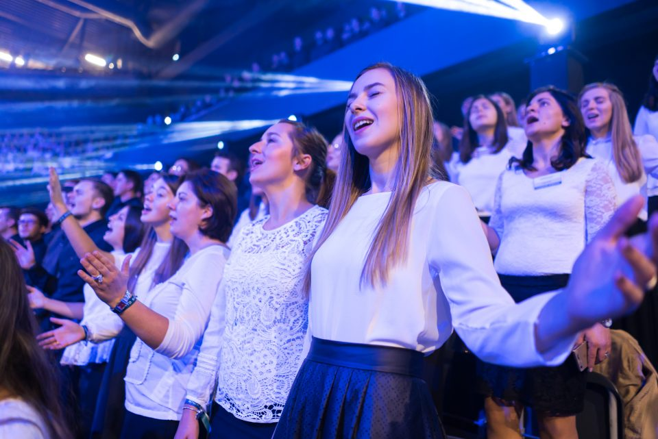 Young girls singing and praising God in the choir