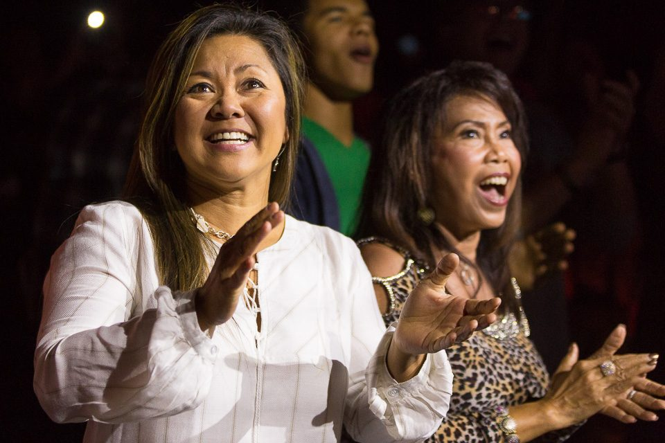 Two women clapping and singing