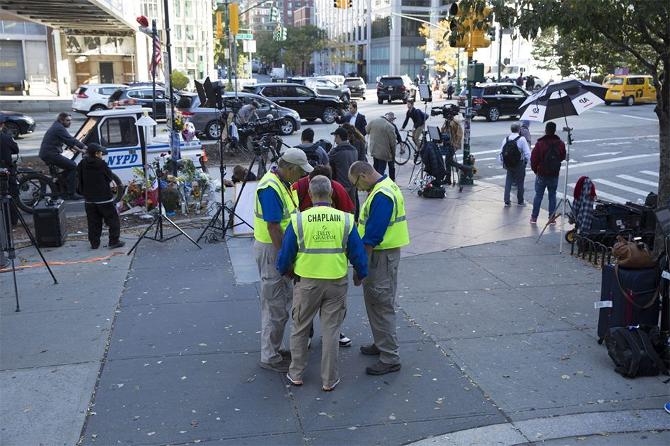 Chaplains circled in prayer near temporary memorial for victims in NYC