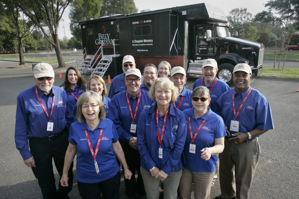 Group picture of Billy Graham chaplains in Santa Rosa standing in front of Rapid Response Team's Mobile Ministry Center