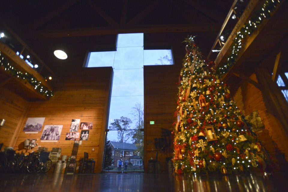 Cross at front entrance of Library and tall Christmas tree