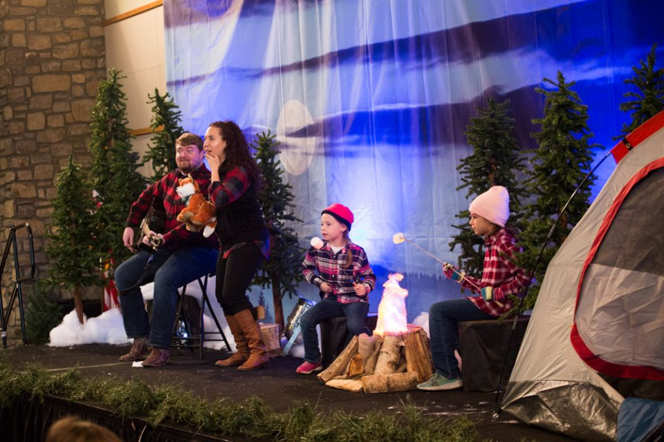 The Christmas story is told and children are led in campfire songs