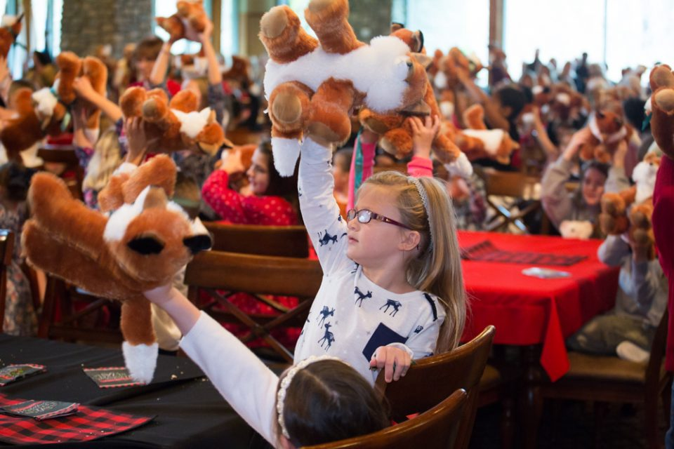Children held up their new plush foxes