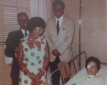 Billy Graham standing beside Wanda Pell's hospital bed