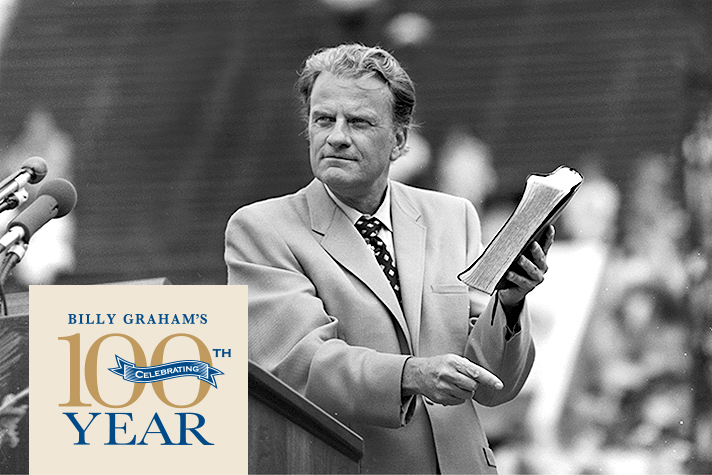 Billy Graham holding Bible