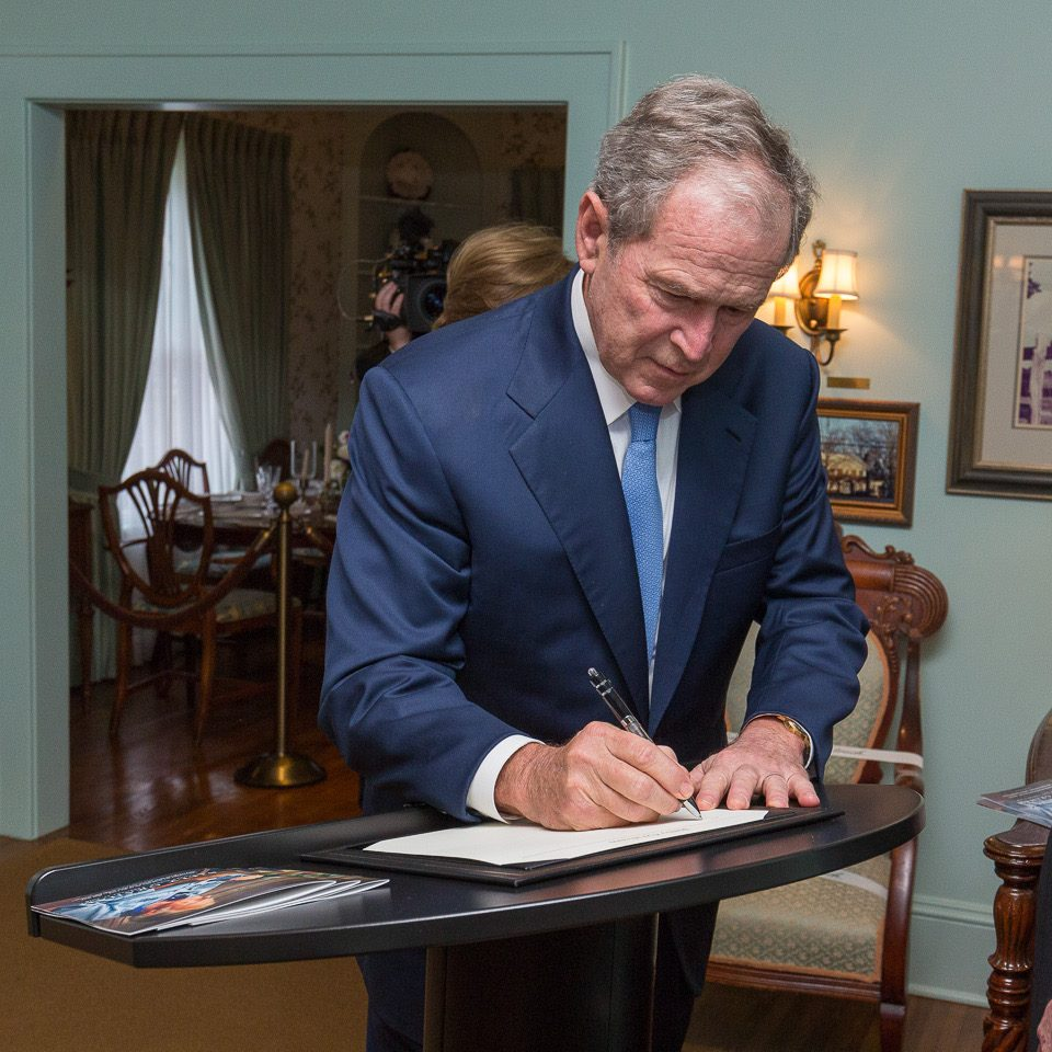 President Bush signs the guest book