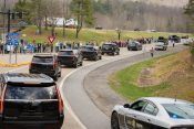 N.C. Residents Line Streets and Highways to Honor Billy Graham as Motorcade Passes By