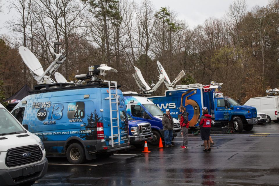 News trucks lined up outside