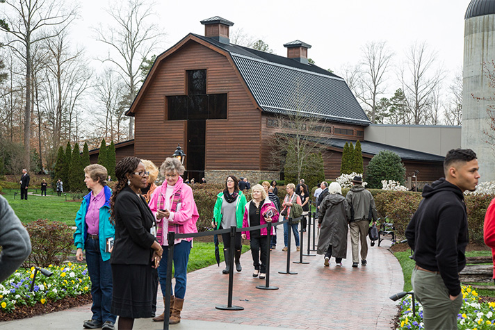 People streaming in front of the Billy Graham Library