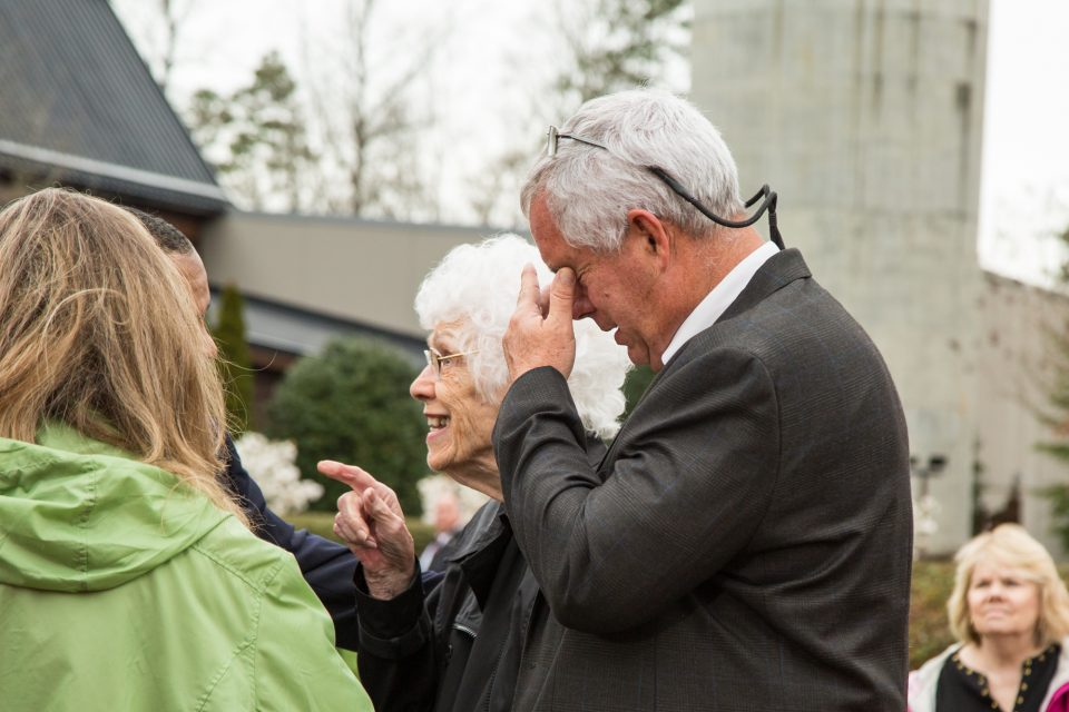 Dave Ballard in tears holding his face, and his mother, Jody