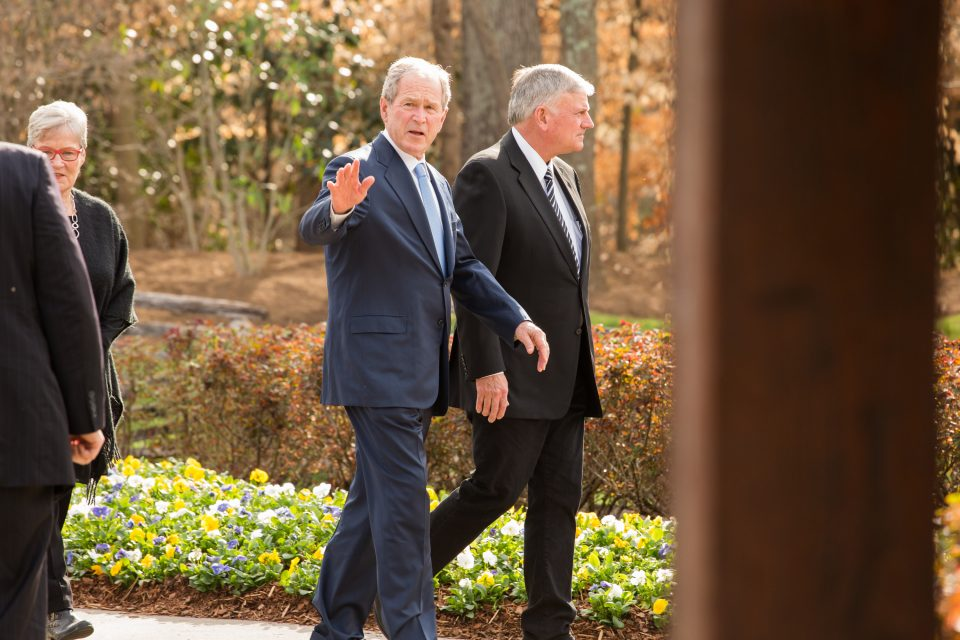 Bush waves good-bye at the end of his visit