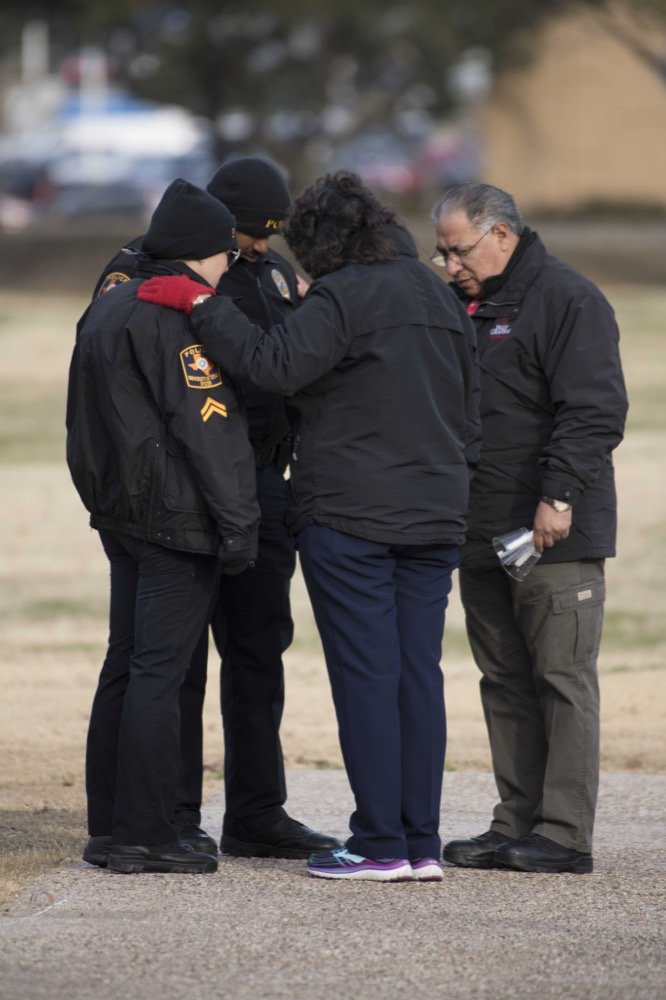 Chaplains pray with first responders