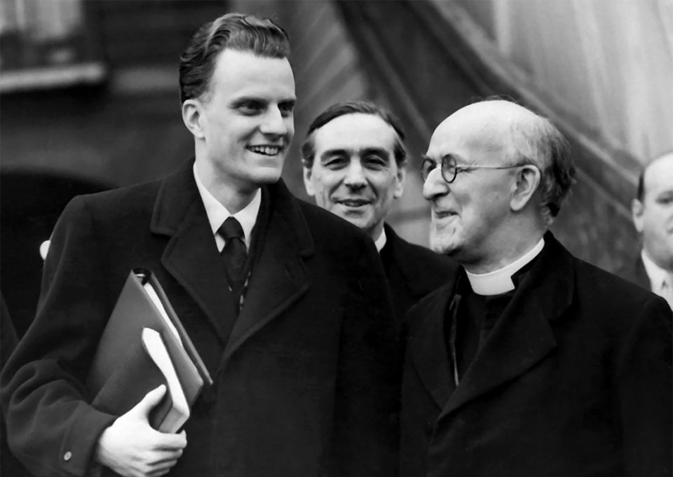Billy Graham holding Bible and talking with Archbishop of Canterbury Geoffrey Fisher