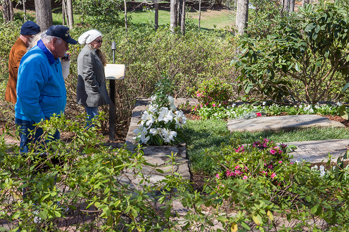 Visitors pay their respects at the graves of Billy and Ruth Graham on Wednesday.