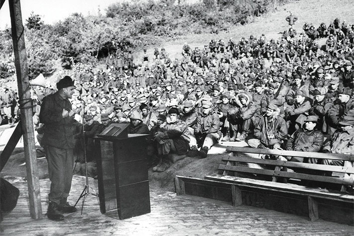 Billy Graham preaching to troops