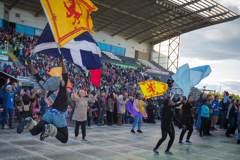 Flags among crowd in stadium