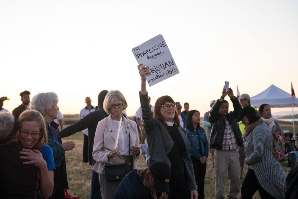 Woman holding sign in support