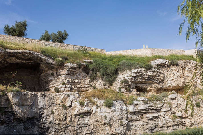 Hill of Golgotha with a wall in the background.