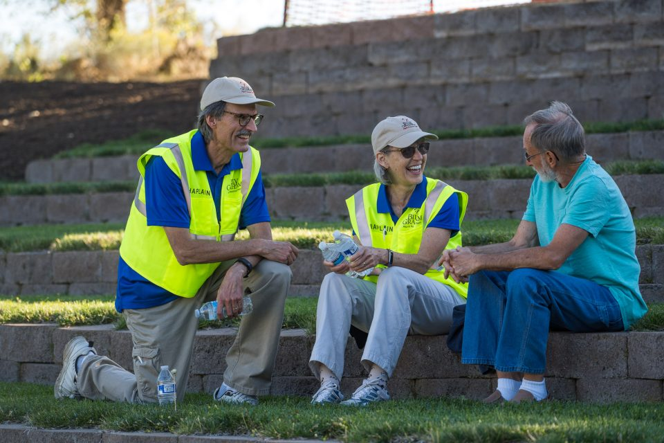 two chaplains sit by a man in Bend