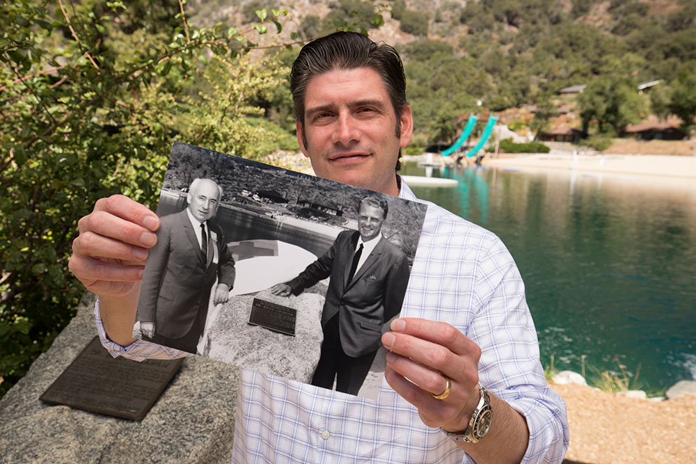 Will Graham holding photo of grandfather Billy Graham and Louis Zamperini
